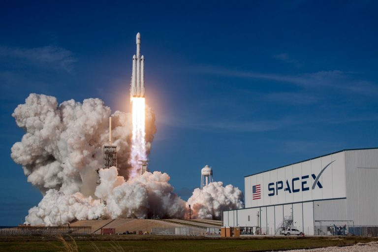 rocket ship launching during daytime